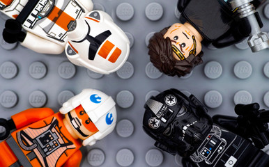 Tambov, Russian Federation - July 06, 2016 Four Lego Star Wars minifigures - Anakin Skywalker, TIE Pilot, Zev Senesca and Republic Trooper - on Lego gray baseplate background. Studio shot.