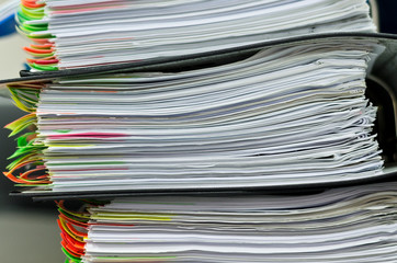 Extremely close up of the stacked office documents