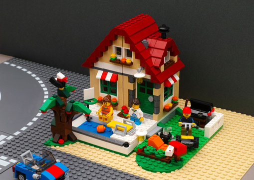 Tambov, Russian Federation - July 28, 2016 Lego Summer House with pool and backyard. There are three minifigures near house and car on road.