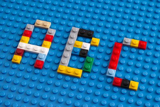 Tambov, Russian Federation - February 20, 2015 Lego custom letter A, B, C on Lego blue baseplate background.