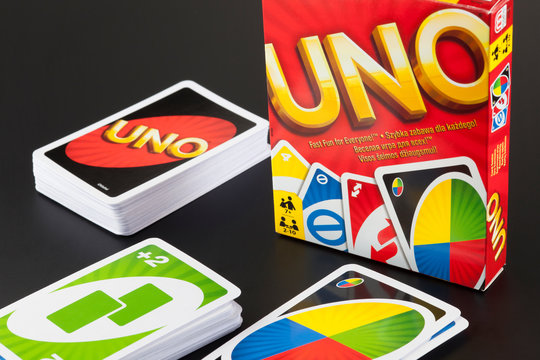 Tambov, Russian Federation - August 15, 2013: Decks of UNO game cards and UNO game box on black background.