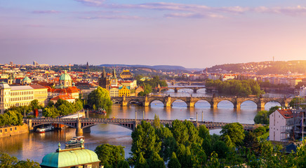Poster Prague Charles Bridge, Prague, Czech Republic. Charles Bridge (Karluv Most) and Old Town Bridge Tower at sunset. Famous iconic image of Charles bridge. Concept of sightseeing and tourism. Czechia