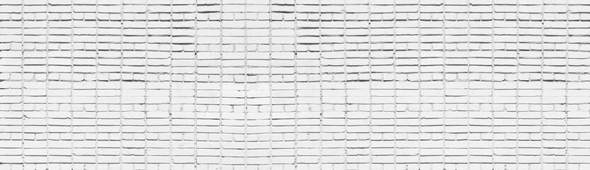 Wide old white brick wall texture. Whitewashed panoramic brickwork background