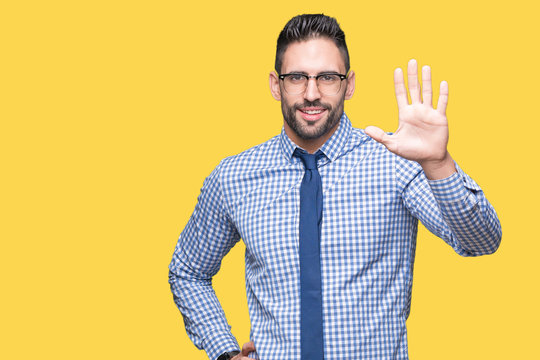Young business man wearing glasses over isolated background Waiving saying hello happy and smiling, friendly welcome gesture