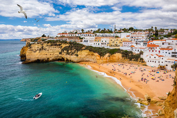 View of Carvoeiro fishing village with beautiful beach, Algarve, Portugal. View of beach in Carvoeiro town with colorful houses on coast of Portugal. The village Carvoeiro in the Algarve Portugal. Fotomurales