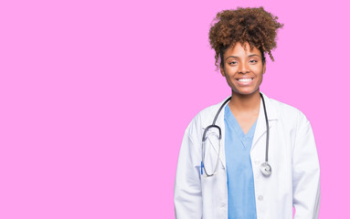 Young african american doctor woman over isolated background with a happy and cool smile on face. Lucky person.