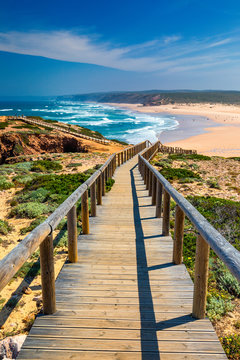 Praia da Bordeira and boardwalks forming part of the trail of tides or Pontal da Carrapateira walk in Portugal. Amazing view of the Praia da Bordeira in portuguese. Bordeira, Algarve, Portugal.