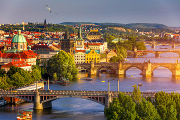 Poster Prague Old Town pier architecture and Charles Bridge over Vltava river in Prague with seagulls, Czech Republic. Prague iconic Charles Bridge (Karluv Most) and Old Town Bridge Tower at sunset, Czechia.