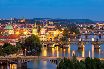 Fotobehang Oost Europa Scenic view of the Old Town pier architecture and Charles Bridge over Vltava river in Prague, Czech Republic. Prague iconic Charles Bridge (Karluv Most) and Old Town Bridge Tower at sunset, Czechia.