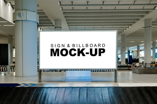 Mock up large blank horizontal billboard at baggage claim point