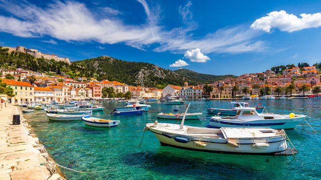 View at amazing archipelago with fishing boats in town Hvar, Croatia. Harbor of old Adriatic island town Hvar. Popular touristic destination of Croatia. Amazing Hvar city on Hvar island, Croatia.