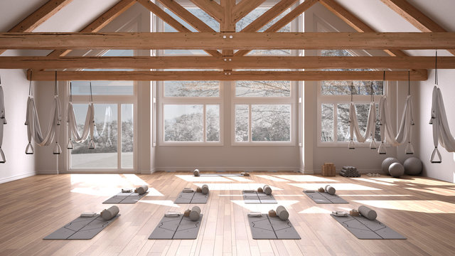 Empty yoga studio interior design, space with hammock, mats, pillows and accessories, wooden floor and roof, ready for yoga practice, meditation, panoramic window with winter panorama