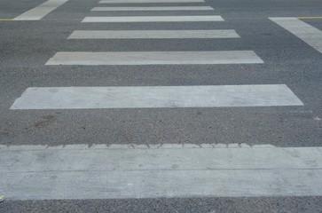 Crosswalk sign on the street for safty people for across the street.