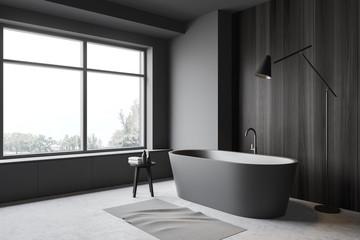 Grey and wood bathroom corner, tub and lamp