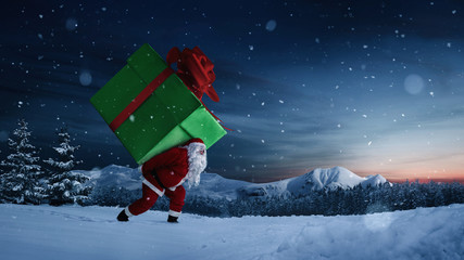 Santa Claus carrying huge christmas gift at night with copy space