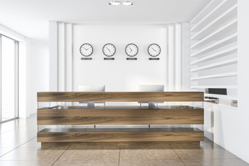 White office reception desk with clocks