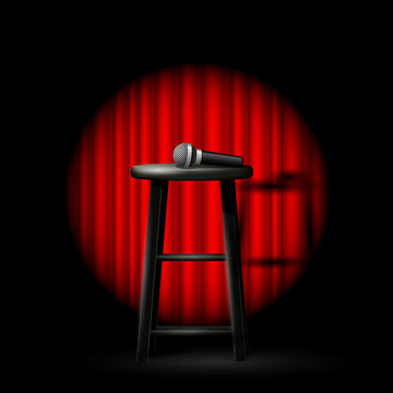 Stand up comedy show - microphone and stool in ray of spotlight and drop-curtain