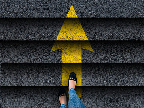woman legs in shoes climbing stairs with arrow. business. success or progress concept