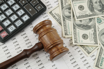 Business concept with calculator, judge gavel, money and documents