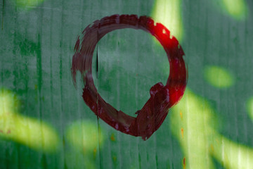 Write the zen circle on the banana leaf, the nature cycle concept