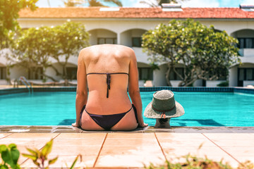 Girl without head near the pool. Funny photo