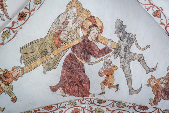 Jesus carries the cross to Calvary and Simon of Cyrene is compelled to help him