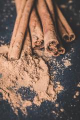 Cinnamon sticks and cinnamon powder on wood food photography