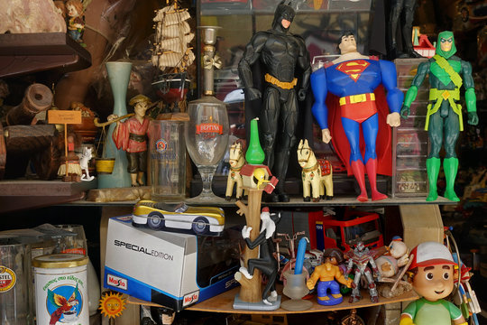 superhero action figures at antiques store