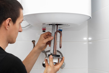 the master repairs the boiler