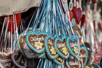 typical gingerbread hearts at the oktoberfest in munich 2019 with the word Oktoberfest on it