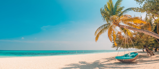Fototapete - Tropical beach panorama as summer landscape with beach swing or hammock and white sand and calm sea for beach banner. Perfect beach scene vacation and summer holiday concept. Boost up color process