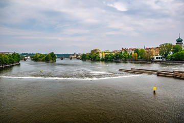 Scenic view of bridges on the Vltava river and historical center of Prague, old town buildings and landmark, Prague, Czech Republic
