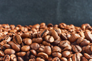 Roasted coffee beans close-up, can be used as a different background. Space is provided for your text.