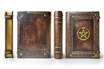 Rich decorated brown leather book with the gilded pentagram and ouroboros symbol