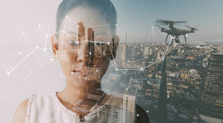 Double exposure of businesswoman and cityscape with Wireless network and Connection technology.