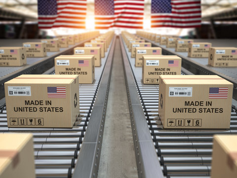 Made in USA United States. Cardboard boxes with text made in USA and american flag on the roller conveyor.