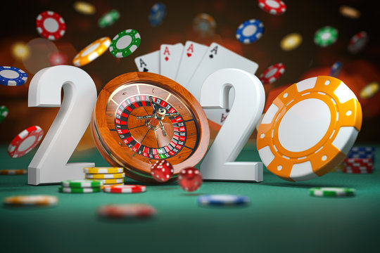 2020 Happy New Year in casino. Numbers 2020 from roulette and casino chips with dice and card on green table.
