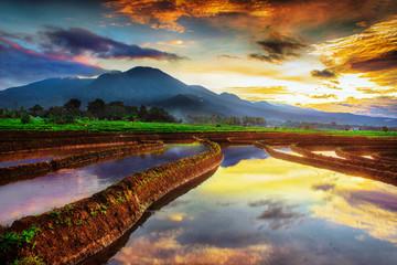 beauty morning sky reflection in amazing mountain range. bengkulu, indonesia