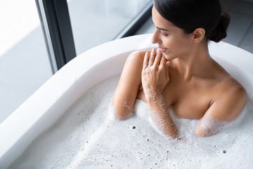 Obraz Relaxed young lady is having a bath - fototapety do salonu