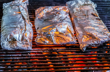 grilling barbecue on aluminum foil
