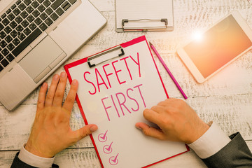 Writing note showing Safety First. Business concept for said to mean that it is best to avoid any unnecessary risks