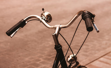 Foto auf Leinwand Fahrrad ANCIENT BIKE HANDLEBAR PARKED IN A STREET OF MADRID. VINTAGE PHOTOGRAPHY.