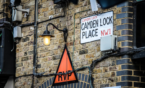 CAMDEN TOWN, LONDON, UNITED KINGDOM - 2017: Camden Lock Place N.W.1 Streetsign surrounded by wiring and CCTV. Camden Town is a popular attraction for the alternative scene.