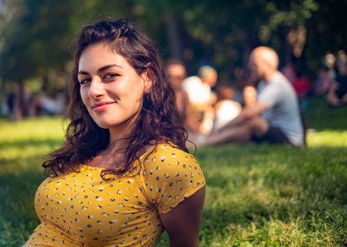 Beautiful millennial woman in a park