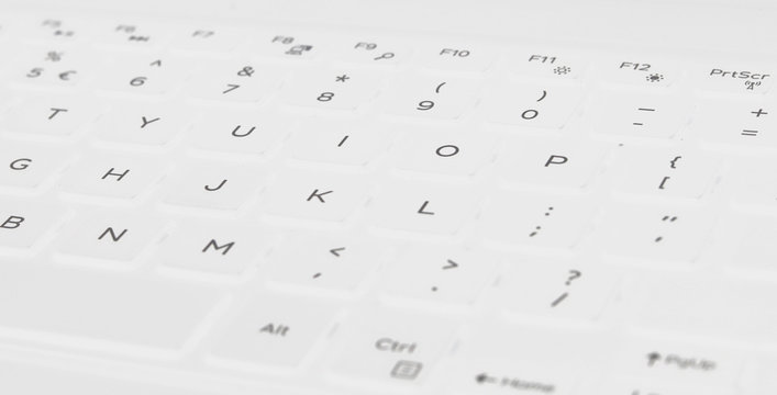 White keyboard layout with pop up white light and gray button name.