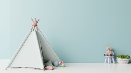 Mock up in children's playroom with tent and table sitting doll on empty blue wall background.