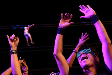 Fans of The Black Eyed Peas cheer during the Rock in Rio music festival in Rio de Janeiro
