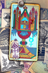Spoed Fotobehang Imagination Ace of tarot cups on a background of esoteric cards, and astrological and alchemical symbols