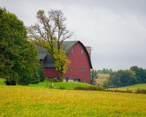 Old red barn on farmland
