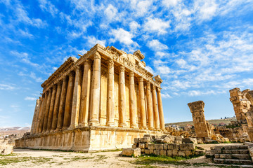 Ancient Roman temple of Bacchus with surrounding ruins with blue sky in the background, Bekaa Valley, Baalbek, Lebanon